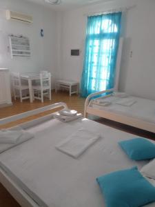Säng eller sängar i ett rum på Princess Santorini Villa