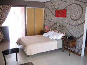 A bed or beds in a room at Rent in Baires