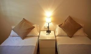 A bed or beds in a room at Alguera Apartments Sant Andreu
