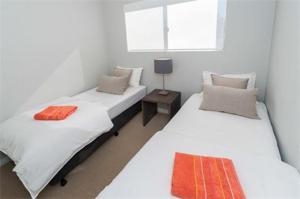 Cama ou camas em um quarto em Bondi Executive - A Bondi Beach Holiday Home