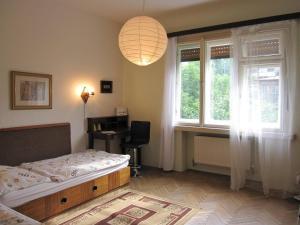 Ein Bett oder Betten in einem Zimmer der Unterkunft Apartmán Franek