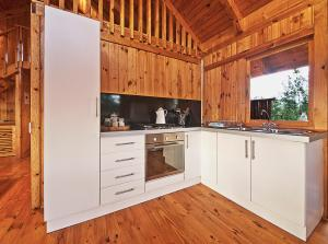 A kitchen or kitchenette at Reflections Eco-Reserve