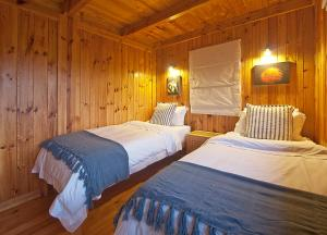 A bed or beds in a room at Reflections Eco-Reserve