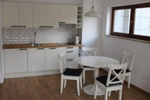A kitchen or kitchenette at Baltic Sea Apartment