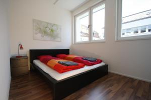 A bed or beds in a room at HITrental Badenerstrasse Apartments