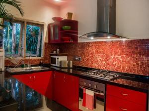 A kitchen or kitchenette at Villa Rama Sita