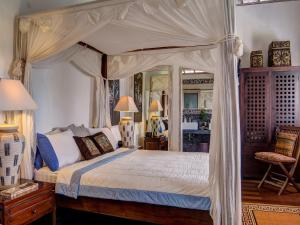 A bed or beds in a room at Villa Rama Sita