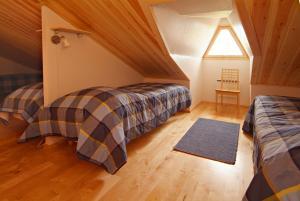 Ліжко або ліжка в номері Polar Star Origo Apartments
