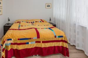 海維費斯格塔公寓酒店房間的床