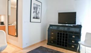 A television and/or entertainment center at City Center Luxury Apartment