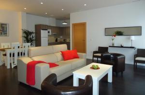 A seating area at Apartamentos Turísticos Mauror