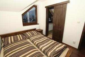 A bed or beds in a room at Horske Domy