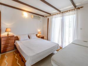 Кровать или кровати в номере Captain Apartments