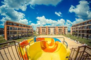 The swimming pool at or near Holiday and Orchid Fort Noks Apartments