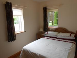 A bed or beds in a room at Birchdale Apartment