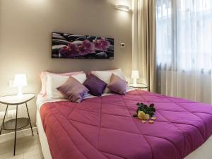 Een bed of bedden in een kamer bij La Farina Apartments