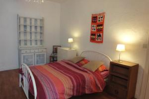 A bed or beds in a room at Le Studio de Christine