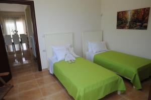 A bed or beds in a room at Villa Nimertis