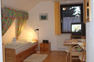 Ein Bett oder Betten in einem Zimmer der Unterkunft Haus Linda