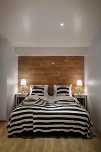 Postelja oz. postelje v sobi nastanitve Thoristun Apartments