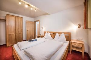 מיטה או מיטות בחדר ב-Appartements Salzburgerhof