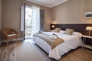 A bed or beds in a room at Habitat Apartments Barcelona Balconies