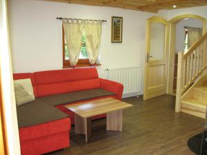 A seating area at Chalet Brložnica pod Veliko planino