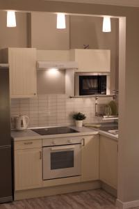A kitchen or kitchenette at My Home Star Aparthotel