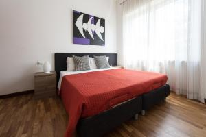 A bed or beds in a room at Residenza Cenisio