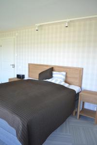 Voodi või voodid majutusasutuse Sjöbredareds Gård toas