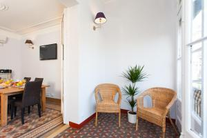 A seating area at Key Vintage - Passeig de Gracia Apartment