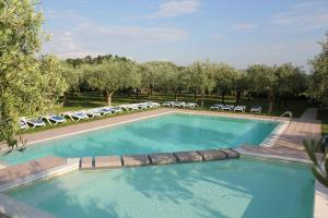 The swimming pool at or near Locanda Ulivi
