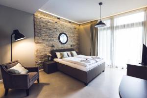 מיטה או מיטות בחדר ב-Heritage Home Apartments