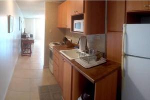 Nhà bếp/bếp nhỏ tại Cond. Marina Lanais