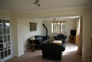 A seating area at Leeds Castle Holiday Cottages