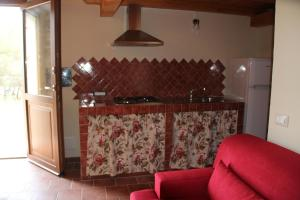A kitchen or kitchenette at Stazzo Gallurese La Cugara