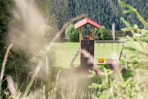 Children's play area at Ferienwohnungen Sumperer