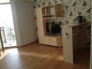 A television and/or entertainment center at Kobaladze Apartments