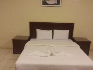 A bed or beds in a room at Romansiyah Aparthotel