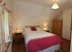 A bed or beds in a room at John Joe's Self Catering
