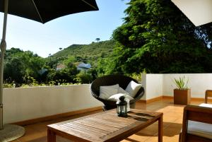 A balcony or terrace at Villa Santa Barbara by be@home