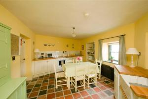 A kitchen or kitchenette at Castletown Round House