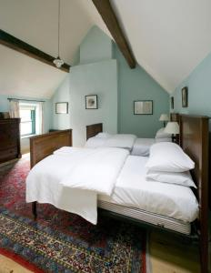 A bed or beds in a room at Castletown Round House