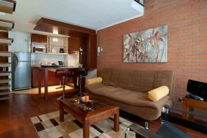 Zona de estar de Park Plaza Apart Hotel