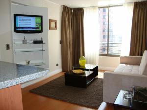 Uma TV ou centro de entretenimento em MG Apartments Providencia
