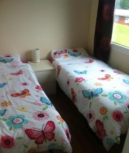 A bed or beds in a room at 9 Sea Valley