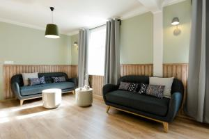 A seating area at Old Charm Reykjavik Apartments