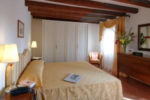 Cama o camas de una habitación en Residence Corte Grimani