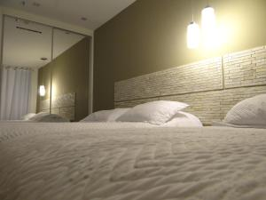 A bed or beds in a room at Mandai Flat Jean