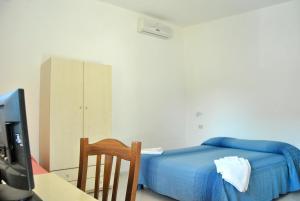 Ein Bett oder Betten in einem Zimmer der Unterkunft C'era Una Volta